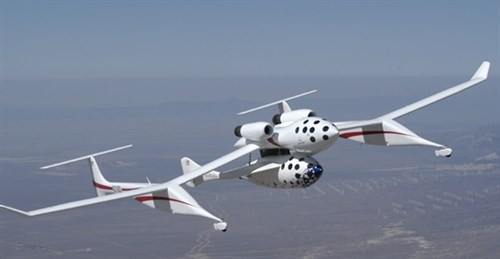 Scaled Composites' SpaceShipOne and White Knight in flight. Here they are still fixed together. Only the engines of the Knight Knight are used here. (permission to use picture from Kaye LeFebvre of Scaled Composites)